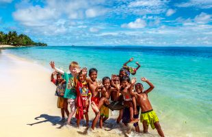 Raja Ampat local children at beach